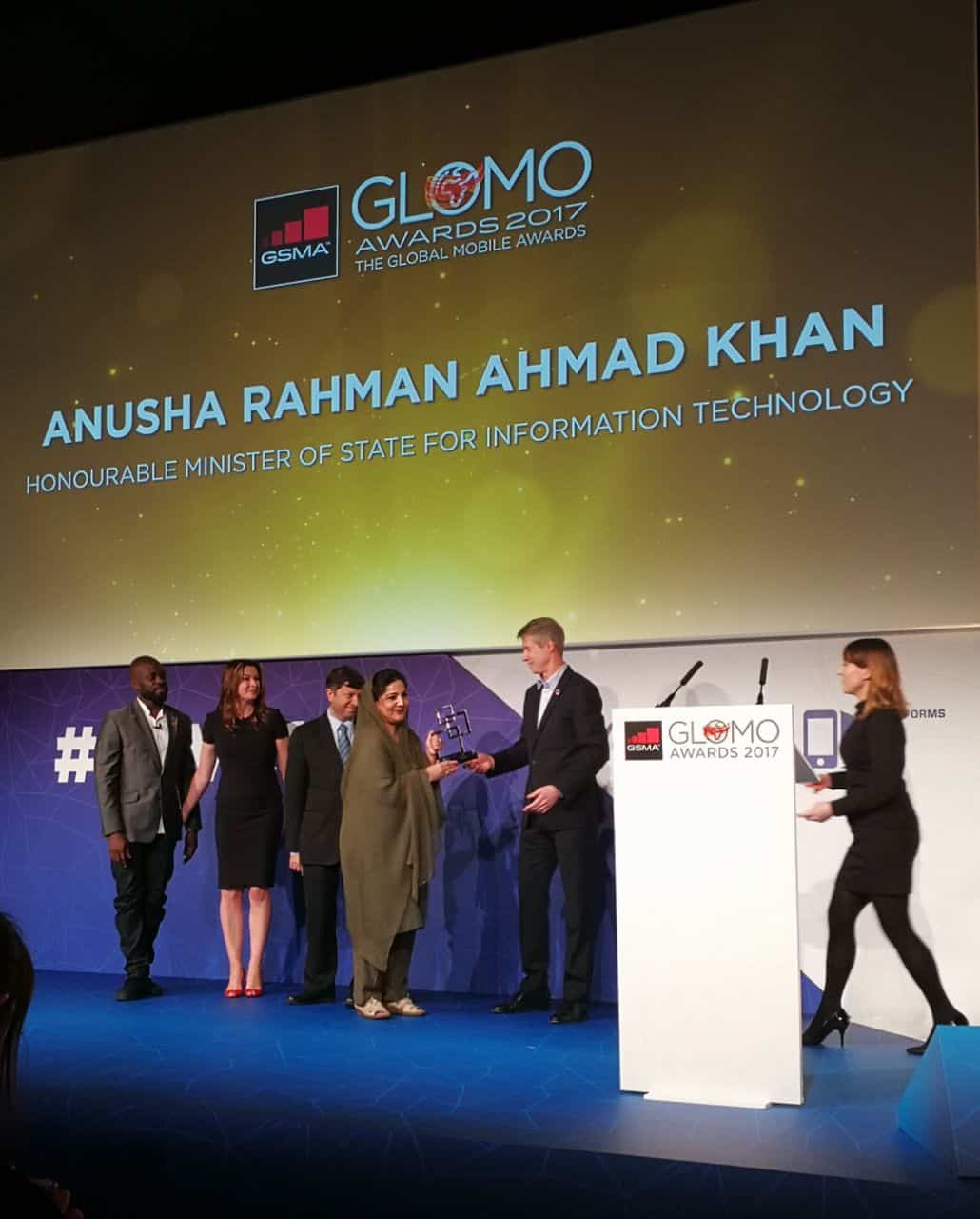 Anusha Rahman receiving award at GLOMO